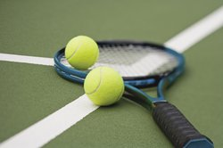 tennis racket stock