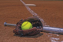 softball in glove stock