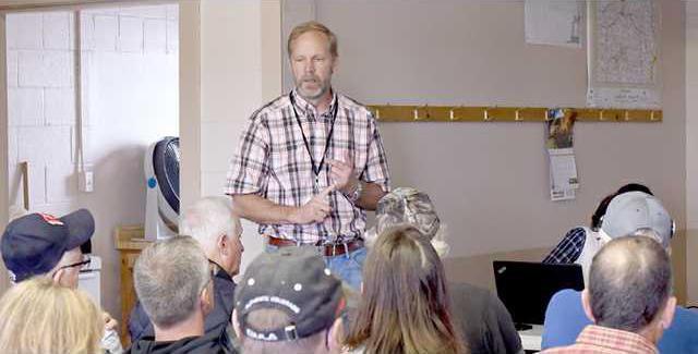Micheel leads dam discussion