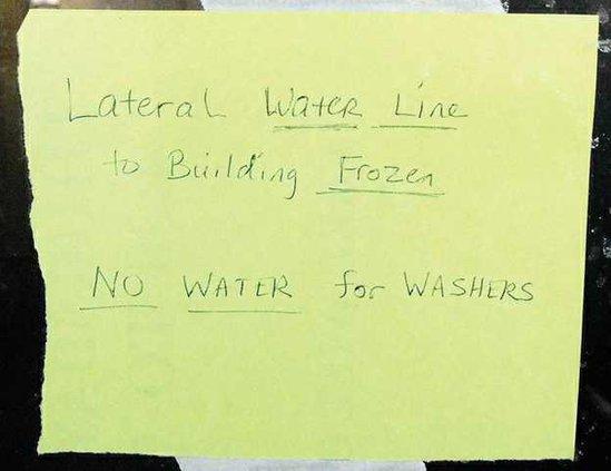 frozen pipe laundromat sign