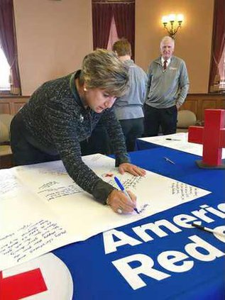shilling signs holiday mail for heroes card