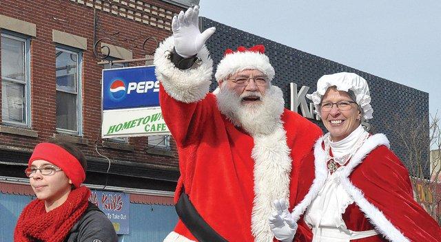 Santa and Mrs. Claus greet parade crowd
