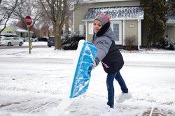 girl shoveling 1