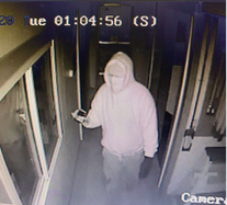 Burglar video still at Davis Welding