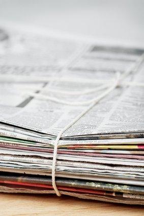 newspaper stock brief