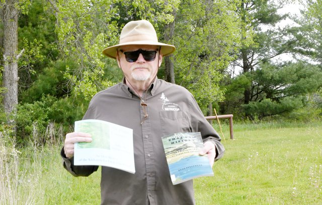 Steinmetz with 'That Dam History' book