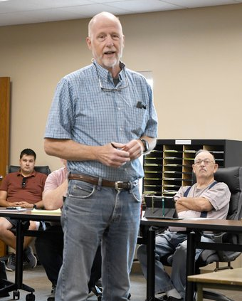 Fred Clark speaks to meeting participants