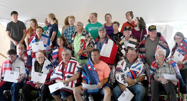 Fourteen vets honored by Quilts of Valor