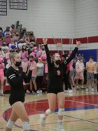 Ellie Eichelkraut, left, and Amber Horn (9) celebrate a turn of events in the first period of New Glarus' three set sweep of Iowa-Grant in the first round of the WIAA Division 3 playoffs Oct. 19.